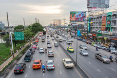 Traffic. Pathumthani,Thailand-August 16,2014 : Evening busy traffic in motion blur car at Ransit road in Pathumthani , Thailand Stock Image