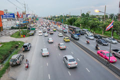 Traffic. Pathumthani,Thailand-August 16,2014 : Evening busy traffic in motion blur car at Ransit road in Pathumthani , Thailand Royalty Free Stock Image