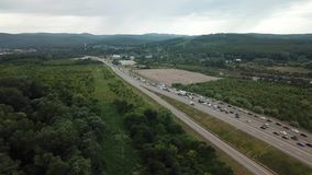 Drone Point of view - aerial view of freeway rush hour traffic jam highway. Traffic at peak hour with cars on the road, over the bridge stock video