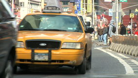 Traffic and People in the center of Times Square stock video footage
