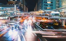 Traffic and people moving through Osaka at night Stock Photo