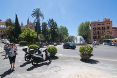 Traffic by the Plaza de la Reina. PALMA DE MALLORCA, BALEARIC ISLANDS, SPAIN - APRIL 13, 2016: Traffic by the Plaza de la Reina on a sunny spring day in Palma de stock photography