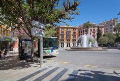 Traffic by the Plaza de la Reina. PALMA DE MALLORCA, BALEARIC ISLANDS, SPAIN - APRIL 13, 2016: Traffic by the Plaza de la Reina on a sunny spring day in Palma de royalty free stock photography