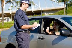 Traffic police. Checking driver's license Stock Photos