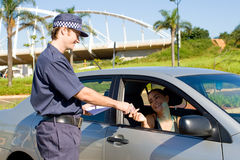 Traffic police. Checking driver's license Royalty Free Stock Images