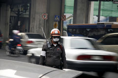 Traffic police in bad environment. Police working the streets stock images