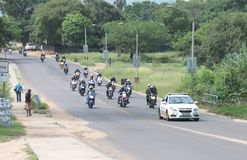 Traffic Police Car Guiding Motorbikes through city streets Stock Images