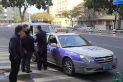 Traffic police in dealing with taxi accident Stock Image