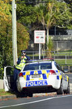 Traffic Police officer. AUCKLAND,NZ - JUNE 03 2014:Traffic Police officer pointing his radar gun at speeding traffic.Traffic Police Monitor traffic to ensure Stock Photos