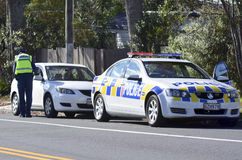 Traffic Police officer. AUCKLAND,NZ - JUNE 03 2014:Traffic Police officer writing a traffic citation. Traffic Police Monitor traffic to ensure motorists observe Stock Photo