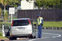 Traffic Police officer. AUCKLAND,NZ - JUNE 03 2014:Traffic Police officer writing a traffic citation. Traffic Police Monitor traffic to ensure motorists observe Royalty Free Stock Photography