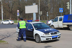 The traffic police officer at the official car Royalty Free Stock Photography