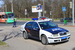 The traffic police officer at the official car Stock Image