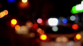 Traffic police officers works on the street. Policeman at work. Police emergency lights flash at night. Car accident. Crime scene. Blurred stock footage