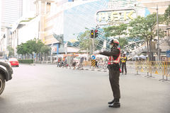 Traffic police redirect car out of Pathumwan intersection. Bangkok, Thailand - January 14, 2015 Traffic police redirect car out of Pathumwan intersection during Stock Photography