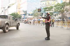 Traffic police redirect car out of Pathumwan intersection. Bangkok, Thailand - January 14, 2015 Traffic police redirect car out of Pathumwan intersection during Stock Photos