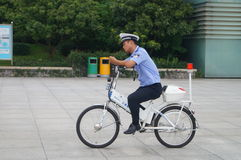Traffic police ride bicycle Stock Image