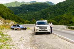 Traffic police work on mountain road Stock Photo