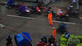 Traffic police working in the rain in Kathmandu, Nepal royalty free stock image