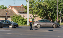 Traffic policeman directing cars in a crossing road. Detail Royalty Free Stock Image