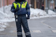 Traffic policeman on duty at winter Stock Photos