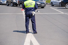 Traffic policeman works on a street at day time Royalty Free Stock Images