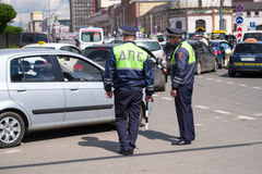 Traffic policeman works on the street at day time Royalty Free Stock Photo