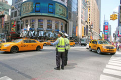Traffic Policemen. Policemen directing the traffic at the Royalty Free Stock Photos