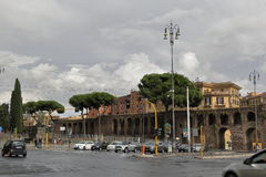 Traffic by Porta San Giovanni in Rome, Italy. Rome, Italy - August 16, 2015: Rainy weather, Porta San Giovanni (gate in the Aurelian Wall of Rome, named after royalty free stock images