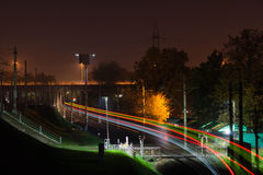 Traffic on railroad tracks at night in city Royalty Free Stock Photography