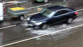 Traffic in rain. Cars passing on road in a rainy day stock footage