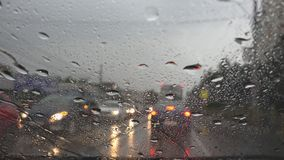Traffic in Rain in City, Driving Car, Heavy Storm on Road, Highway, Rainy Drops stock photography