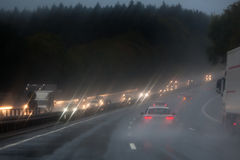 Traffic on the rainy autobahn Stock Photos