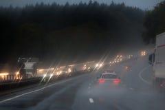 Traffic on the rainy autobahn. Evening traffic on the rainy autobahn stock photos