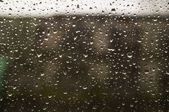 Traffic in rainy day with road view through car window with rain drops. Traffic in rainy day with road view through car window with rain drops stock images