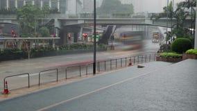 Traffic on the Rainy Street of Hong Kong. Hong Kong City. Heavy rain on the street. Car and bus traffic stock video footage