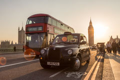 Traffic and random people on Westminster Bridge in sunset, London, UK. stock photos