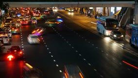 Traffic at Ratchaprasong Intersection in Bangkok, Thailand time lapse. Bangkok, Thailand - December 13: Traffic at Ratchaprasong Intersection December 13, 2015 stock footage