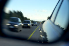 Traffic through rear mirror royalty free stock image