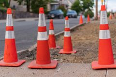 Traffic red cones on street warning construction works. Next on street Royalty Free Stock Image