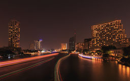 Traffic in the river on night city skyline background Royalty Free Stock Photography