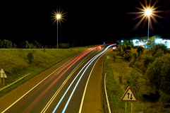 Traffic on the road. A trail of lights showing the traffic on the road royalty free stock photos