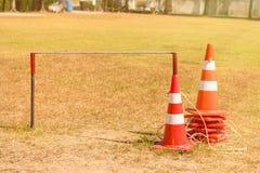 Traffic road cone pylon on green grass. Traffic road cone pylon on green grass Royalty Free Stock Photos