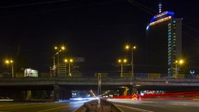 Traffic at the road junction. Kiev, Ukraine, 2017. September 2. Time laps. Night traffic on a two-level road. A view of the building of the Ministry of stock video footage