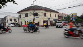Traffic on the road of Luang Prabang stock video footage