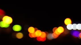 Blurred bokeh, traffic on the road at night in a big city, stock footage