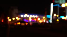 Traffic on the road at night in a big city, blurred bokeh stock video