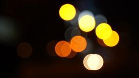 Blurred bokeh, traffic on the road at night in a big city, stock video footage