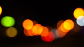 Traffic on the road at night in a big city, blurred bokeh stock video footage