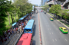 Traffic on the road and people wait buses at Jatujak bus station Stock Photo